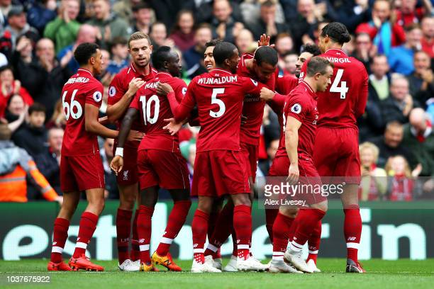 Joel Matip of Liverpool celebrates with teammates after scoring his team's second goal during the Premier League match between Liverpool FC and...