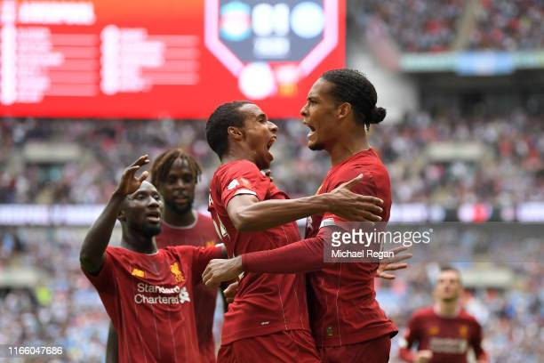 Joel Matip of Liverpool celebrates with teammates after scoring his team's first goal during the FA Community Shield match between Liverpool and...