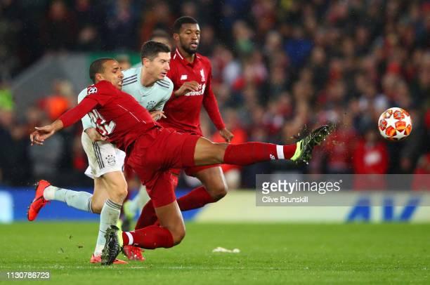 Joel Matip of Liverpool clears from Robert Lewandowski of Bayern Munich during the UEFA Champions League Round of 16 First Leg match between...