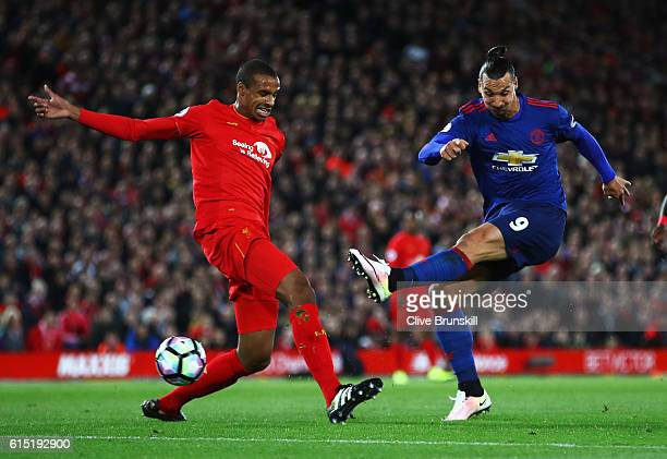 Joel Matip of Liverpool closes down Zlatan Ibrahimovic of Manchester United as he shoots during the Premier League match between Liverpool and...