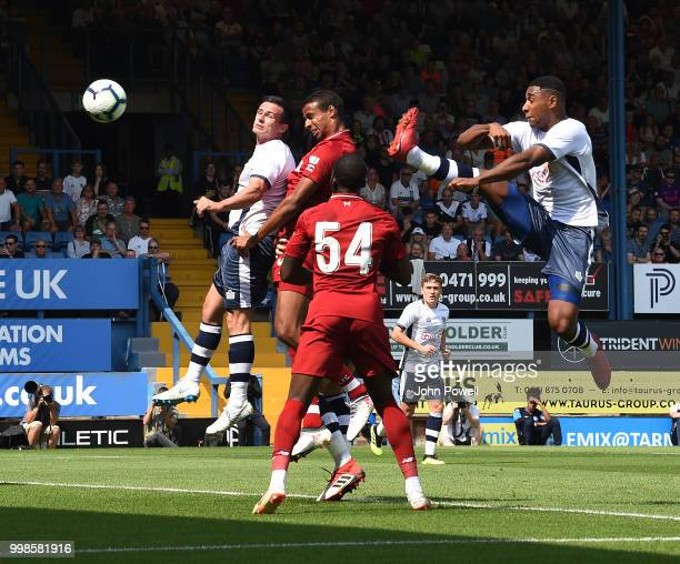 Joel Matip of Liverpool comes close during the PreSeason friendly match between Bury and Liverpool at Gigg Lane on July 14 2018 in Bury England