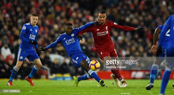 Joel Matip of Liverpool competes with Wilfred Ndidi Leicester City the Premier League match between Liverpool FC and Leicester City at Anfield on...