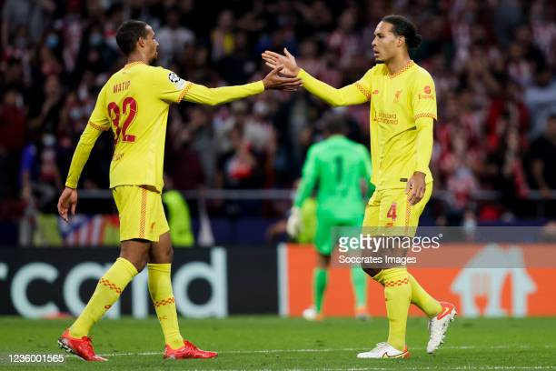 Joel Matip of Liverpool FC, Virgil van Dijk of Liverpool FC celebrate the victory during the UEFA Champions League match between Atletico Madrid v...