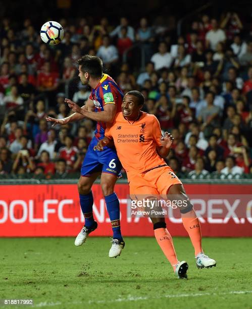 Joel Matip of Liverpool goes up with Scott Dann of Crystal Palace during the Premier League Asia Trophy match between Liverpool FC and Crystal Palace...