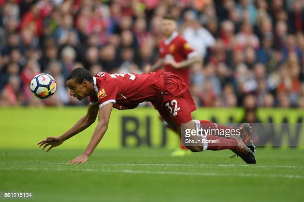 Joel Matip of Liverpool heads the ball during the Premier League match between Liverpool and Manchester United at Anfield on October 14 2017 in...