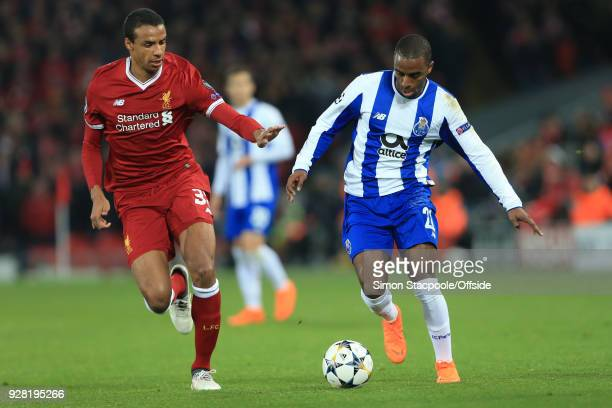 Joel Matip of Liverpool in action with Ricardo Pereira of FC Porto during the UEFA Champions League Round of 16 Second Leg match between Liverpool...