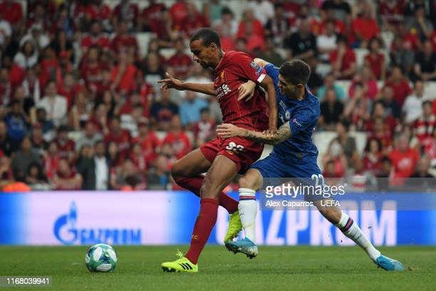 Joel Matip of Liverpool is challenged by Christian Pulisic of Chelsea during the UEFA Super Cup match between Liverpool and Chelsea at Vodafone Park...