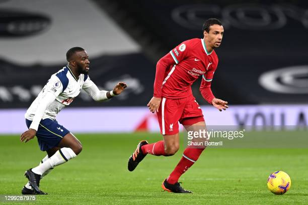 Joel Matip of Liverpool is challenged by Tanguy Ndombele of Tottenham Hotspur during the Premier League match between Tottenham Hotspur and Liverpool...