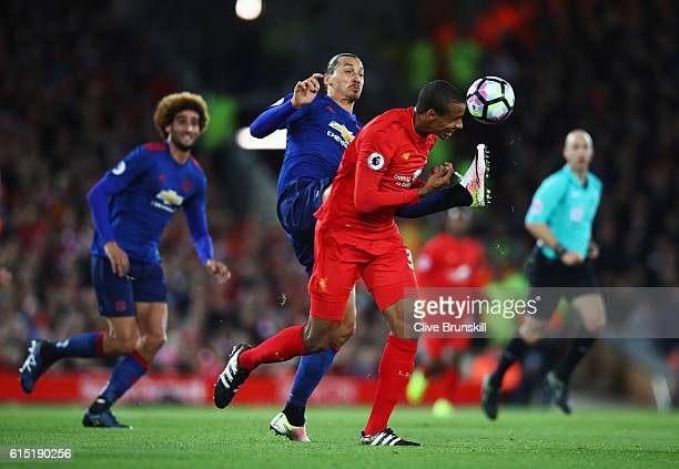 Joel Matip of Liverpool is challenged by Zlatan Ibrahimovic of Manchester United during the Premier League match between Liverpool and Manchester...