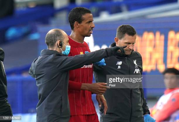Joel Matip of Liverpool is seen to by medical staff during the Premier League match between Everton FC and Liverpool FC at Goodison Park on June 21,...