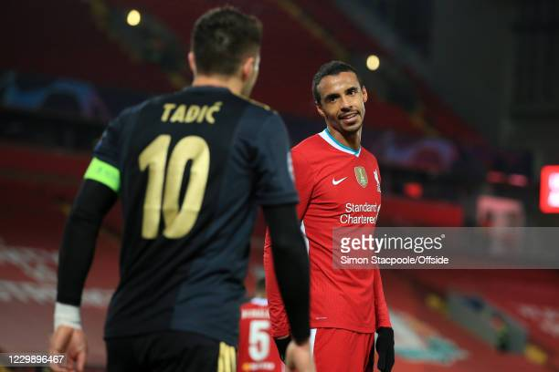 Joel Matip of Liverpool looks apologetically towards Dusan Tadic of Ajax during the UEFA Champions League Group D stage match between Liverpool FC...