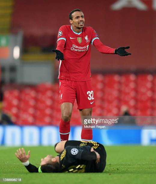 Joel Matip of Liverpool reacts during the UEFA Champions League Group D stage match between Liverpool FC and Ajax Amsterdam at Anfield on December...
