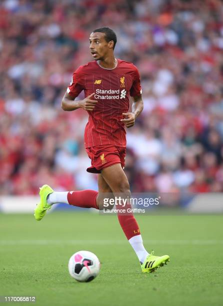 Joel Matip of Liverpool runs with the ball during the Premier League match between Liverpool FC and Arsenal FC at Anfield on August 24 2019 in...