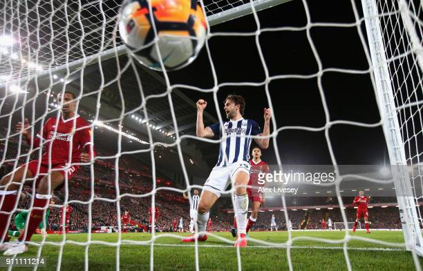 Joel Matip of Liverpool scores an own goal as Jay Rodriguez of West Bromwich Albion celebrates during The Emirates FA Cup Fourth Round match between...
