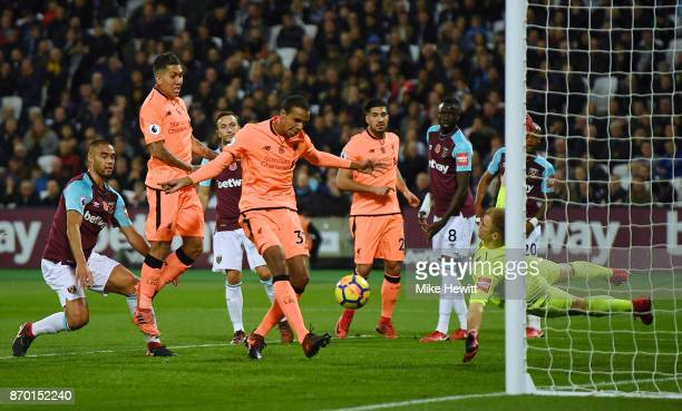 Joel Matip of Liverpool scores his sides second goal during the Premier League match between West Ham United and Liverpool at London Stadium on...
