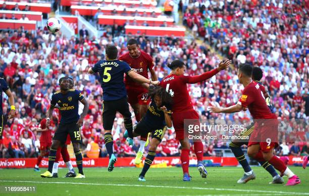 Joel Matip of Liverpool scores his teams first goal during the Premier League match between Liverpool FC and Arsenal FC at Anfield on August 24 2019...