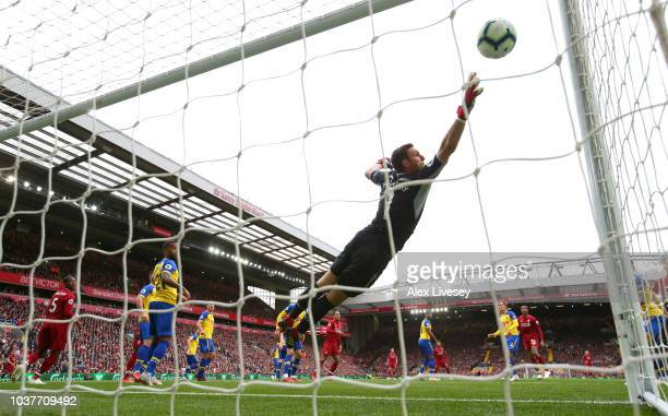 Joel Matip of Liverpool scores his team's second goal past Alex McCarthy of Southampton during the Premier League match between Liverpool FC and...