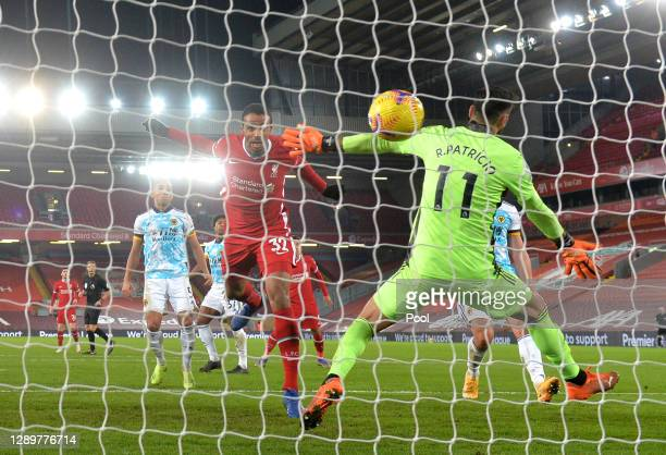 Joel Matip of Liverpool scores their sides third goal past Rui Patricio of Wolverhampton Wanderers during the Premier League match between Liverpool...