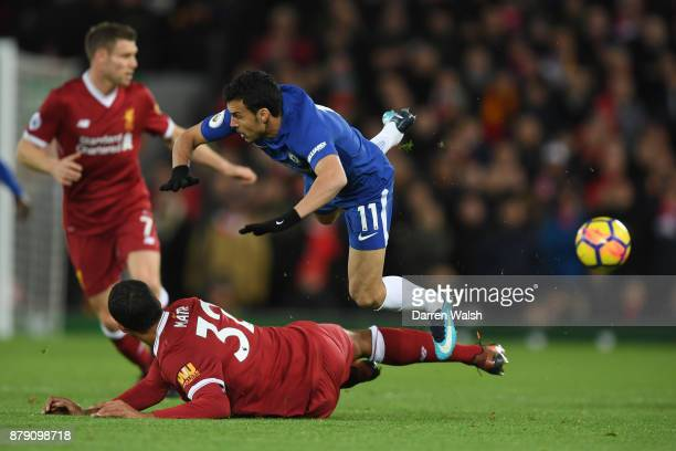 Joel Matip of Liverpool tackles Pedro of Chelsea during the Premier League match between Liverpool and Chelsea at Anfield on November 25 2017 in...