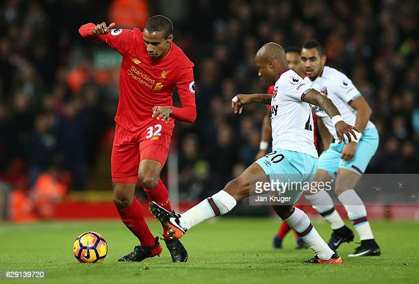 Joel Matip of Liverpool takes on Andre Ayew of West Ham United during the Premier League match between Liverpool and West Ham United at Anfield on...