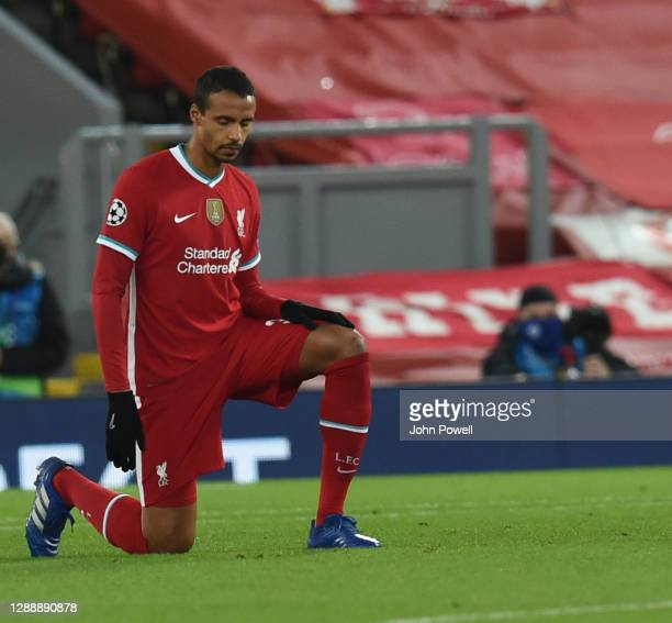 Joel Matip of Liverpool takes to the knee the UEFA Champions League Group D stage match between Liverpool FC and Ajax Amsterdam at Anfield on...