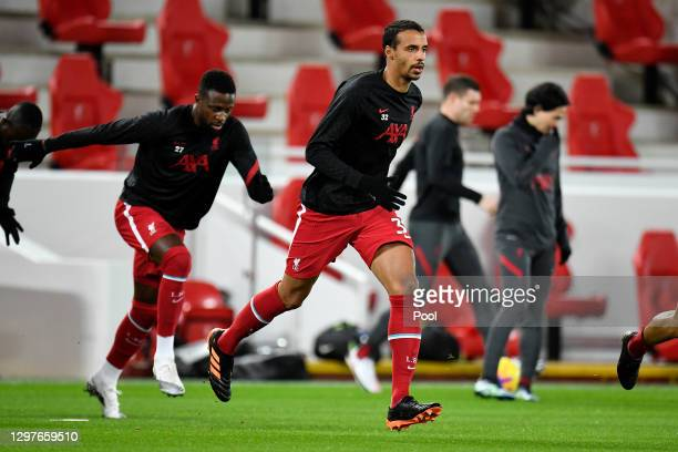 Joel Matip of Liverpool warms up ahead of the Premier League match between Liverpool and Burnley at Anfield on January 21, 2021 in Liverpool,...