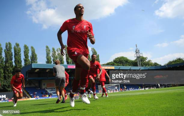 Joel Matip of Liverpool warms up before the preseason friendly match between Bury and Liverpool at Gigg Lane on July 14 2018 in Bury England