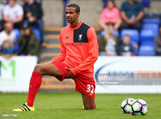 Joel Matip of Liverpool warms up during the PreSeason Friendly match between Tranmere Rovers and Liverpool at Prenton Park on July 8 2016 in...