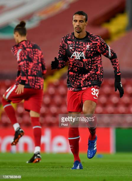 Joel Matip of Liverpool warms up prior to the UEFA Champions League Group D stage match between Liverpool FC and Atalanta BC at Anfield on November...