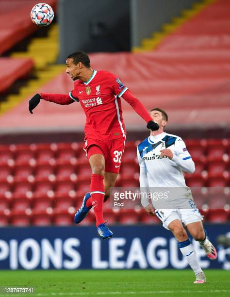 Joel Matip of Liverpool wins a header during the UEFA Champions League Group D stage match between Liverpool FC and Atalanta BC at Anfield on...