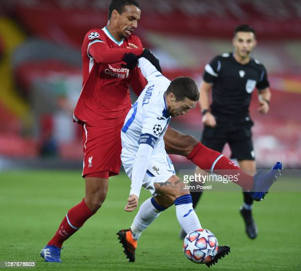 Joel Matip of Liverpool with Alejandro Gomez of Atalanta during the UEFA Champions League Group D stage match between Liverpool FC and Atalanta BC at...