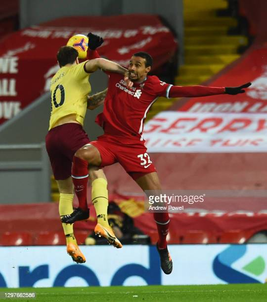 Joel Matip of Liverpool with Burnley's Ashley Barnes during the Premier League match between Liverpool and Burnley at Anfield on January 21, 2021 in...