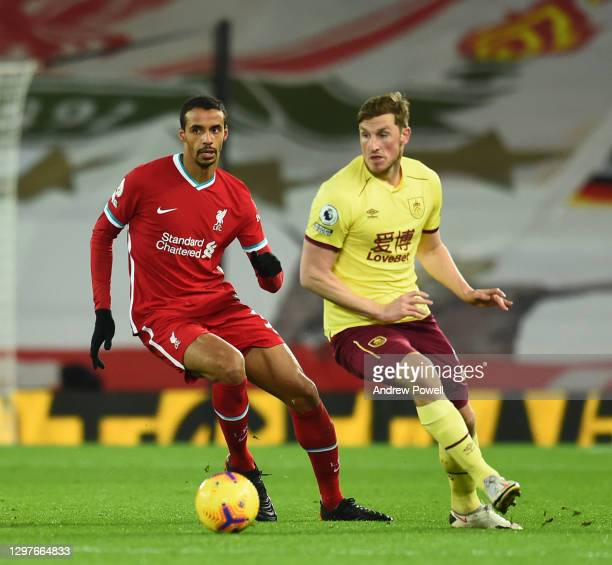 Joel Matip of Liverpool with Burnley's Chris Wood during the Premier League match between Liverpool and Burnley at Anfield on January 21, 2021 in...