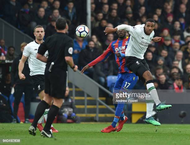 Joel Matip of Liverpool with Christian Benteke of Crystal Palace during the Premier League match between Crystal Palace and Liverpool at Selhurst...