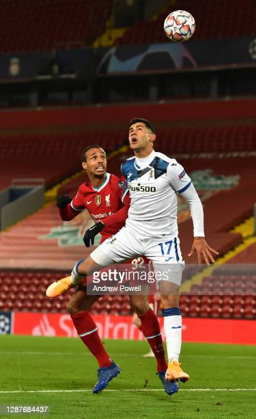 Joel Matip of Liverpool with Cristian Romero of Atalanta during the UEFA Champions League Group D stage match between Liverpool FC and Atalanta BC at...