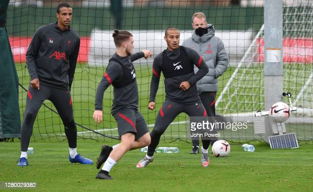 Joel Matip of Liverpool with Harvey Elliott of Liverpool and Thiago Alcantara of Liverpool during a training session at Melwood Training Ground on...