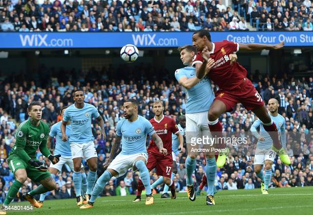 Joel Matip of Liverpool with John Stones of Man City during the Premier League match between Manchester City and Liverpool at Etihad Stadium on...