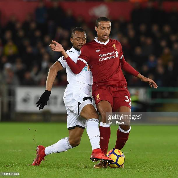 Joel Matip of Liverpool with Jordan Ayew of Swansea during the Premier League match between Swansea City and Liverpool at Liberty Stadium on January...