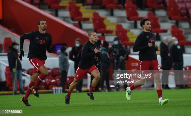 Joel Matip of Liverpool with Thiago Alcantara of Liverpool and Trent Alexander-Arnold of Liverpool before the Premier League match between Liverpool...