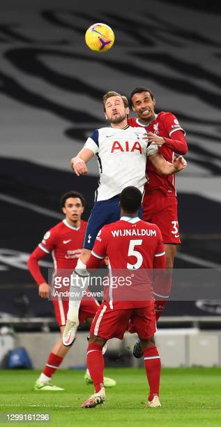 Joel Matip of Liverpool with Tottenham Hotspur's Harry Kane during the Premier League match between Tottenham Hotspur and Liverpool at Tottenham...