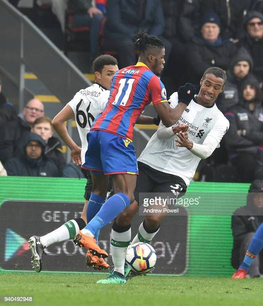 Joel Matip of Liverpool with Wilfried Zaha of Crystal Palace during the Premier League match between Crystal Palace and Liverpool at Selhurst Park on...