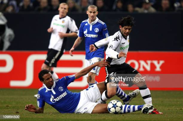 Joel Matip of Schalke and Banega Ever of Valencia battle for the ball during the UEFA Champions League round of 16 second leg match between Schalke...