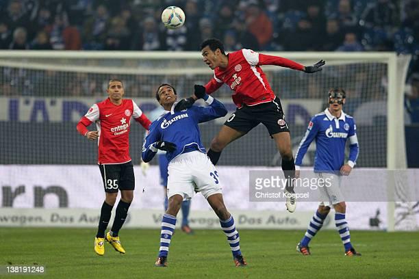 Joel Matip of Schalke and Eric Maxim ChoupoMoting of Mainz go up for a header during the Bundesliga match between FC Schalke 04 and FSV Mainz 05 at...