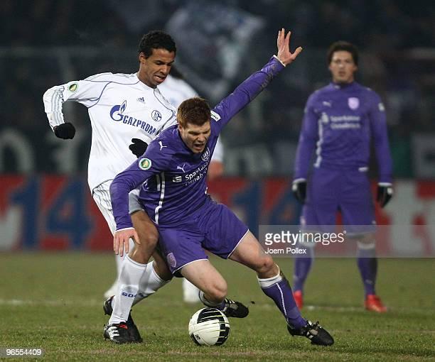 Joel Matip of Schalke and Nils Hansen of Osnabrueck battle for the ball during the DFB Cup quarter final match between VfL Osnabrueck and FC Schalke...