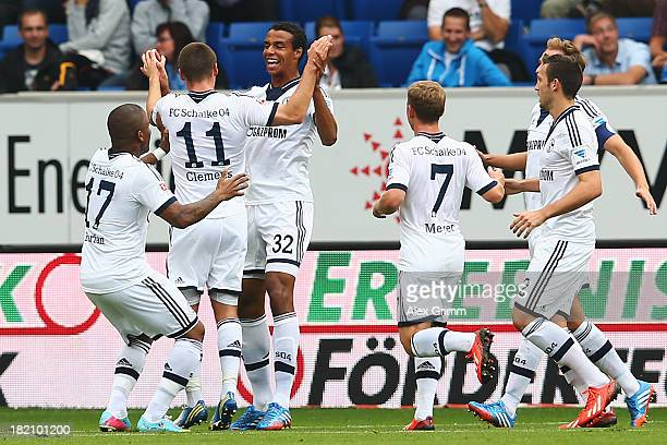 Joel Matip of Schalke celebrates his team's second goal with team mates during the Bundesliga match between 1899 Hoffenheim and FC Schalke 04 on...
