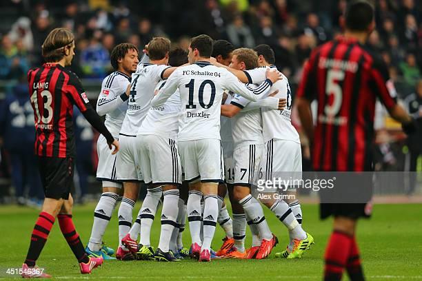 Joel Matip of Schalke celebrates his team's second goal with team mates during the Bundesliga match between Eintracht Frankfurt and FC Schalke 04 at...