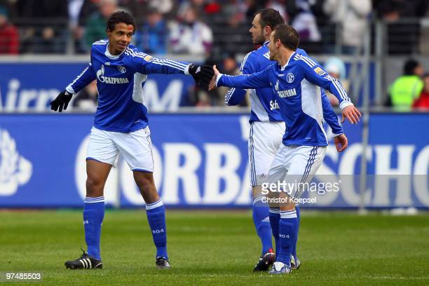 Joel Matip of Schalke celebrates the first goal with Lukas Schmitz of Schalke during the Bundesliga match between Eintracht Frankfurt and FC Schalke...