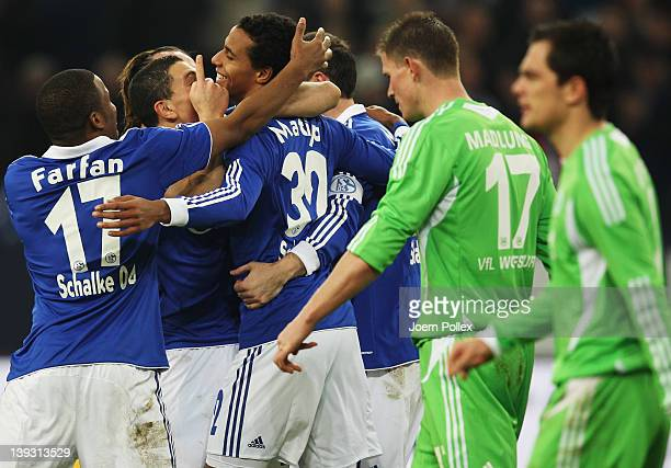 Joel Matip of Schalke celebrates with his team mates after scoring his team's third goal during the Bundesliga match between FC Schalke 04 and VfL...