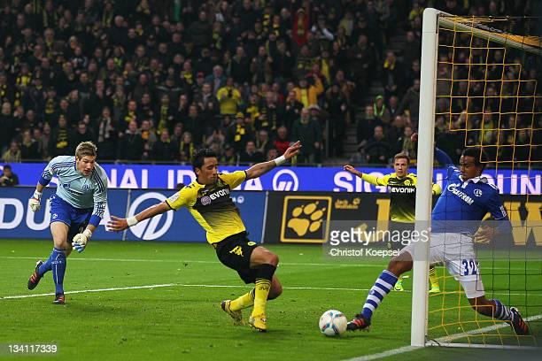 Joel Matip of Schalke saves the ball against Lucas Barrios of Dormtund during the Bundesliga match between Borussia Dortmund and FC Schalke 04 at...