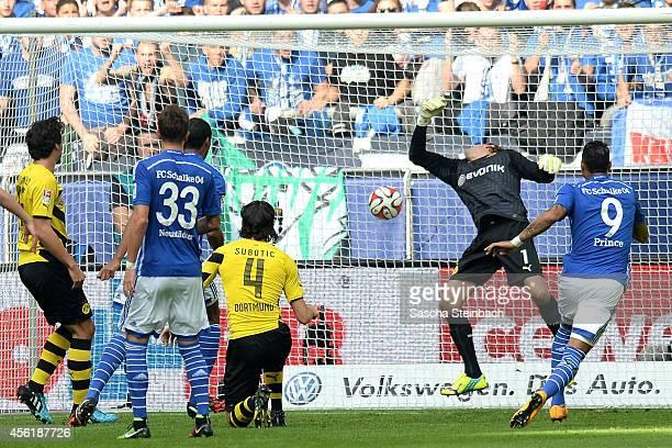 Joel Matip of Schalke scores the opening goal from a header as goalkeeper Roman Weidenfeller of Dortmund tries to save during the Bundesliga match...